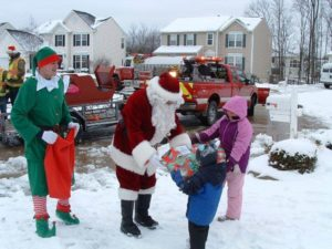 Santa giving a gift to children